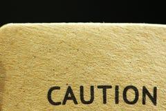 Pappers- varningsetikett Arkivfoton
