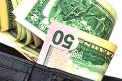 Pappersräkningar Amerikanska dollar sedlar av den olika denominatioen Fotografering för Bildbyråer