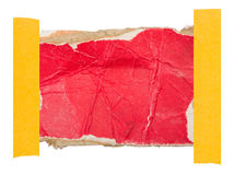 Pappetikett som fästas med ett klibbigt band Royaltyfria Foton