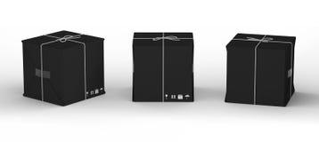 Pappkarton eingewickelt mit schwarzem Papier und mit Schnur gebunden, Lizenzfreies Stockbild