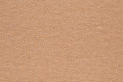Papptexturbakgrund, brun pappers- låda Arkivfoton