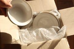 Pappverpackungs-Kasten, Platten und Luftpolsterfolie Lizenzfreies Stockfoto