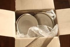 Pappverpackungs-Kasten, Platten und Luftpolsterfolie Lizenzfreie Stockfotos