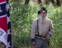 Pappy Walton. Red Bluff, California, United States-April 25, 2015: Colonel Pappy Walton instructs the Confederate troops before a Civil War reenactment at Dog Royalty Free Stock Photography