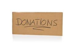 Pappzeichen für Spenden über weißem Hintergrund Lizenzfreie Stockfotos