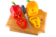 Paprica. Red and yellow sweet pepper lays on a chopping board Stock Images