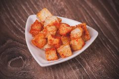 Paprica croutons served in bowl Stock Images