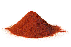 Paprika. Heap of brilliant red sweet paprika, isolated on white royalty free stock photography