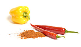 Paprika. Light yellow and hot red paprikas on a white background Stock Photography