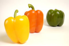 Paprika. Green, yellow and orange paprika on a white background Royalty Free Stock Photos