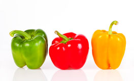 Paprika. Green, red and yellow paprika isolated on white background Stock Image
