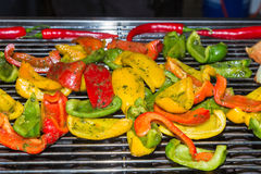 Paprika and chilly on a grill Royalty Free Stock Photos