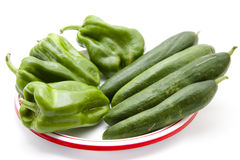 Paprika and cucumbers on plate Stock Photos