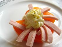 Paprika dish. Gourmet dish with orange paprika and salami, decorated with mayonnaise dressing stock images