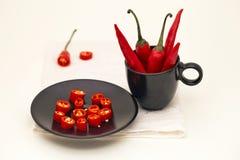 Paprika en una taza negra Imagen de archivo