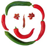 Paprika face. Smile face composited from red and green paprikas Royalty Free Stock Image