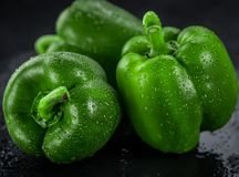 Fresh made Green paprika on a slate slab close-up shot; selecti Royalty Free Stock Photos