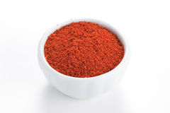 Paprika ground in a bowl on white background. Stock Photography