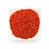 Paprika ground in a white bowl on white royalty free stock photography