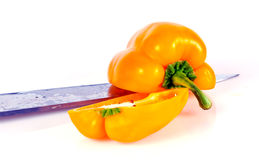 Paprika with knife. Paprika and knife isolated on white background Royalty Free Stock Photography