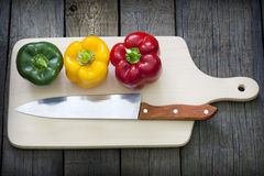 Paprika and knife on cutting board Royalty Free Stock Photo