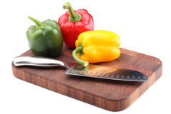 Paprika mix and knife. Paprika mix and kitchen knife on the board, isolated on white Stock Photo