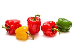 Red, yellow and green paprika on a white background royalty free stock photography