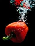 Paprika na água 1 Imagem de Stock