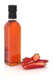 Paprika-Olivenöl und Paprikas Stockbilder
