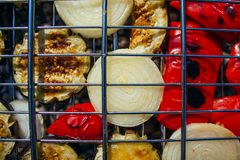 Paprika, onion, eggplant cooked on the barbecue, grill grate royalty free stock photo