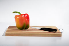 Paprika op scherpe raad Royalty-vrije Stock Foto