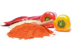 Paprika powder and peppers on white background Stock Images