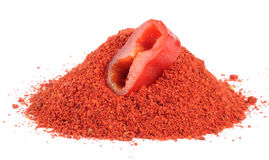 Paprika Powder and Slice of Red Bell Pepper. Paprika powder and a slice of red bell pepper isolated on a white background stock photography