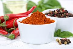 Paprika powder spicy red hot chili peppers chilli cooking ingred Royalty Free Stock Images