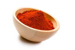 Paprika powder in wooden bowl Royalty Free Stock Photo