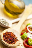 Paprika powder in wooden spoon Royalty Free Stock Photos