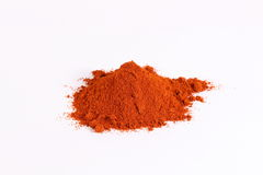 Paprika and red chilli powder. Heap of brilliant red sweet paprika,  on whitenbackground Stock Photography