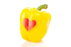 Paprika with red heart. Yellow bell paprika with red heart, isolated on white background royalty free stock image