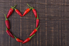Free Paprika Red Pepper In The Shape Of Heart. The Texture On A Wooden Background. Valentine S Day. Royalty Free Stock Photos - 38184678