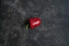 Paprika rojo en fondo oscuro fotos de archivo libres de regalías