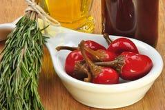 paprika rouge organique de cerise en huile de tournesol Images libres de droits