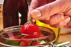 paprika rouge organique de cerise en huile de tournesol Photos libres de droits