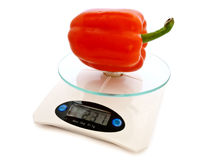 Paprika at scales Royalty Free Stock Images