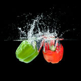 Paprika splash. Fresh  paprika splash in water on black background Stock Photography