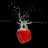 Paprika splash. Fresh  paprika splash in water on black background Stock Image