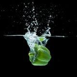 Paprika splash. Fresh  paprika splash in water on black background Stock Photo