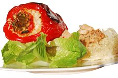 Paprika stuffed with rice. Red paprika stuffed with rice, garnished with lettuce, isolated Stock Photography