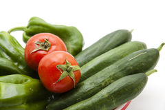 Paprika and tomatoes with cucumbers Stock Photography