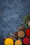 Paprika, turmeric, red pepper and other fragrant spices. Top view stock image