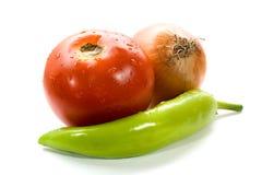 Paprika, Zwiebel und Tomate getrennt auf Weiß Lizenzfreie Stockbilder